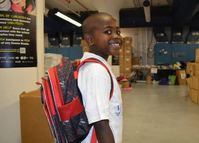 kid_20with_20backpack_20smiling.jpg