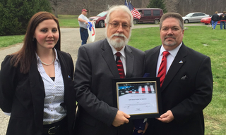 Safe Haven received plaque in honor of supporting Mr. Pawlowski
