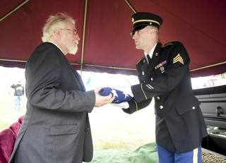 David Wilson accepts Mr. Pawlowski's flag at his funeral