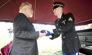 David Wilson, on behalf of The Richard Lugar Safe Haven, accepts Mr. Pawlowski's flag.