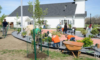Home_20Depot_20working_20in_20Volunteers_20of_20America_20Northern_20Rockies_20Veterans_20Honor_20Garden.jpg