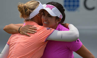 Gerina Piller and Brooke Henderson on the 18th
