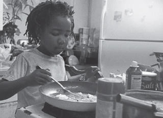 little girl cooking food