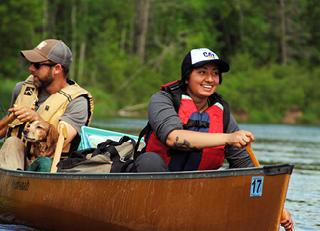 VOA High School student paddling a canoe