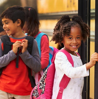 Smiling kids with backpacks - sml