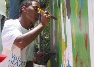 volunteer painting a wall