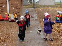 Kids playing outside on a fall day