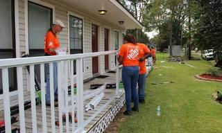 Home_20Depot_20Volunteers_20installing_20a_20railing.jpg