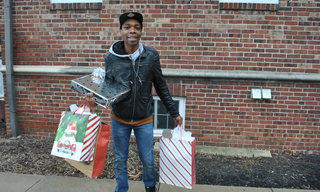 Miles bringing gifts to his family
