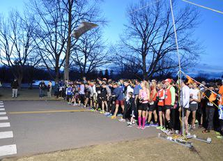 Volunteer at a New Year's Eve 5K Race in Washington Park Denver