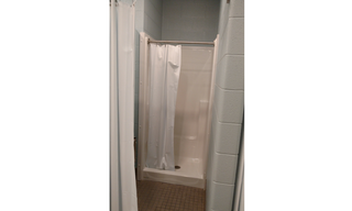A sight so beautiful to our eyes.  A brand new shower ready to go!