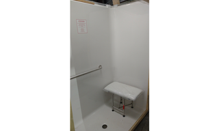 A sneak peek at the fancy new shower stalls, just waiting to be installed.