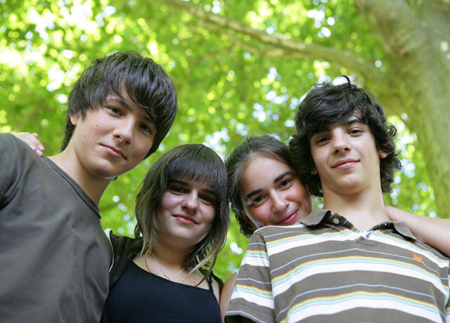 Four adolescents outdoors - small