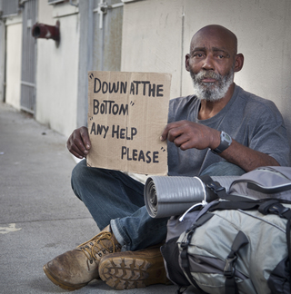 Homeless Man Holding Up Sign for Help