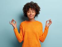 mindful-peaceful-afro-american-woman-meditates-indoor-keeps-hands-mudra-gesture-has-eyes-closed.jpg