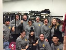 Astrazeneca tackles organizing the clothes closet at Hope Manor I