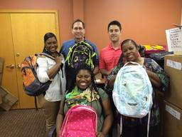 The Cohen team commits to helping stuff backpacks with essential school supplies for our annual Operation Backpack