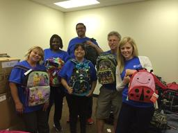 Cision helping pack backpacks for our annual Operation Backpack