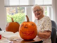 Iona with pumpkin at halloween