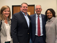 Heather Matthews (Volunteers of America Southeast Louisiana, Gov. John Bel Edwards, David Kneipp (second from left) and Eboness Black (right) from Volunteers of America Greater Baton Rouge