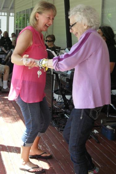 Elderly woman dancing with a staff member