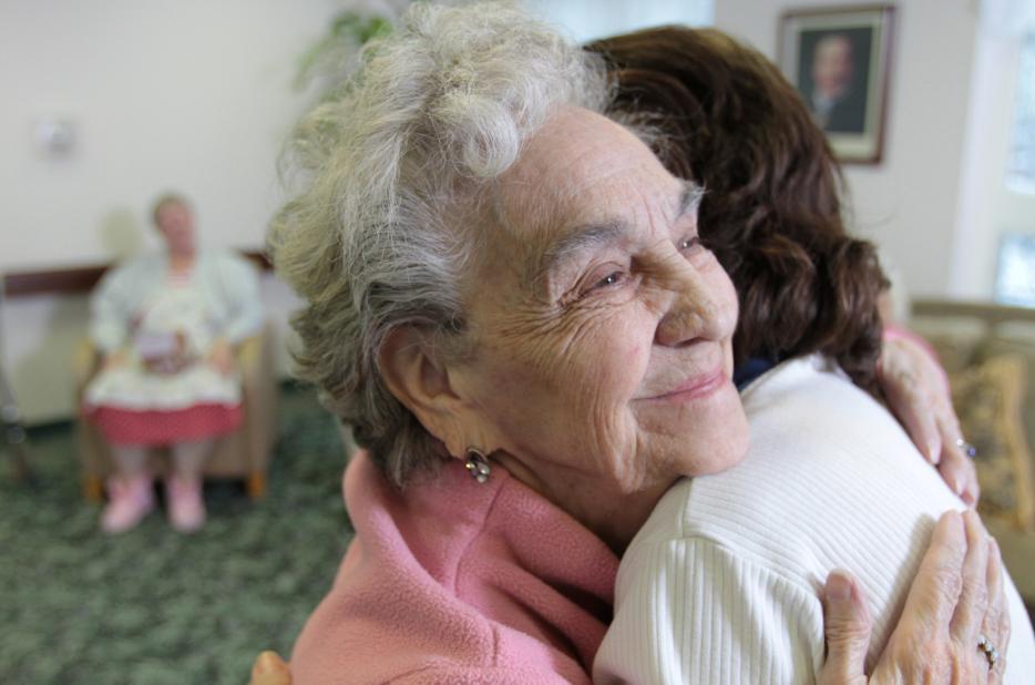 Senior_Woman_Client_Hugging_Volunteers_of_America_Employee.jpg